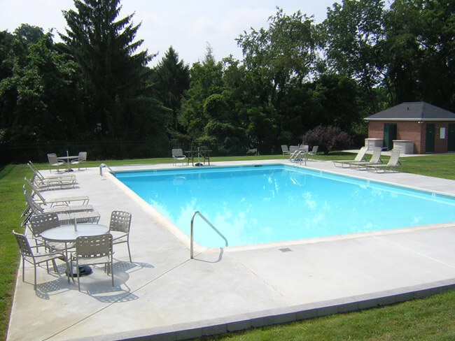 Outdoor in-ground pool and patio tables and chairs